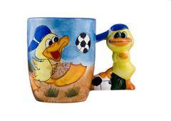 Creative cup with ducks Stock Photos