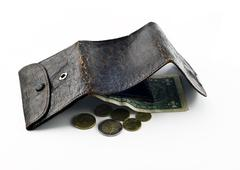Stock Photo of opened frayed leather wallet with one dollar bond and change