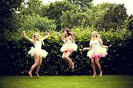 Stock Photo of beautiful happy young women jumping.