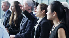 Diverse group of business people attend a business seminar Stock Footage