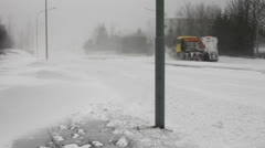 Snowplow snow removal during a whiteout blizzard in Iceland Stock Footage