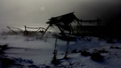 Ruins of an old fishing outpost, Icelandic coast, dark winter blizzard storm Stock Footage