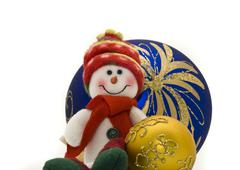 Cute cuddly christmas toy with colorful new year balls Stock Photos