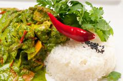 chicken with green curry vegetables and rice - stock photo
