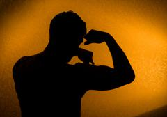 Strength and health. silhouette of man Stock Photos
