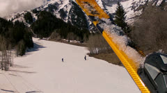 Skiers in the spring from chair lift Stock Footage
