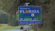 Stock Video Footage of Welcome to Florida border sign from South Georgia, Rick Scott Governor