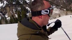 man spring skiing at mountain resort - stock footage