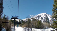 Riding up chair lift at resort Stock Footage