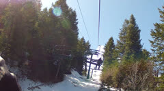 Skiers on the chairlift in spring Stock Footage