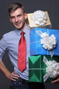 Stock Photo of portrait of young business man with gifts