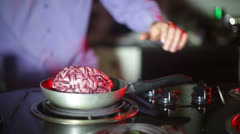 Cannibalism cooking brains cannibal Stock Footage