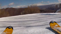 skis going across the spring snow - stock footage