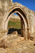 cloister ruins of santa clara velha - stock photo