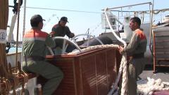 Seamen reeling in rope Stock Footage