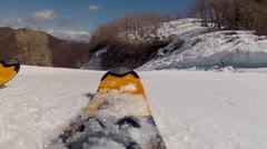 skis going across spring snow - stock footage