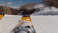 Skis going across spring snow Stock Footage