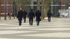 Visitors going to Messe Frankfurt Congress center Germany - stock footage