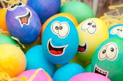 Smiley easter eggs in a holiday basket arrangement Stock Photos