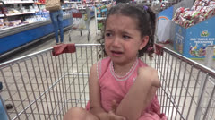 Child cry in supermarket Stock Footage