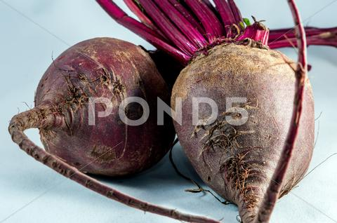 Stock photo of two beetroots over white background