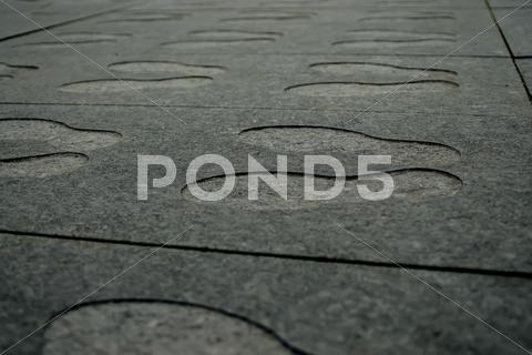 Stock photo of shoeprint in granite stone