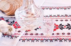 vodka in decanter, bread and garlic - stock photo