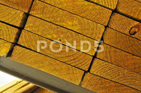 Stock photo of stack of wood to be used on a home