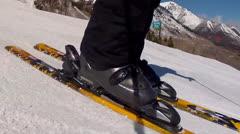 man skiing across snow - stock footage