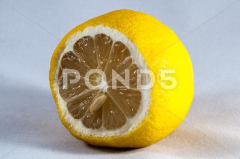 Stock photo of cut of lemon on a white background
