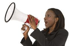 African woman shouting through a megaphone Stock Photos