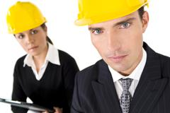 Man and woman industrial partnership Stock Photos