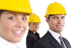 two women and man business team in industry - stock photo
