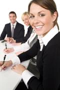 Happy business meeting team man and two women Stock Photos