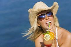 Stock Photo of woman happy smiling drinking a cocktail