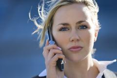 executive businesswoman on phone in city - stock photo