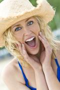 Surprised beautiful woman girl in straw hat Stock Photos