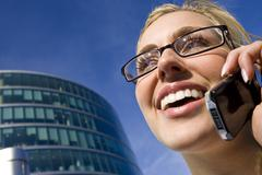 Businesswoman executive on phone in city Stock Photos