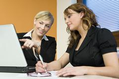 Two women colleagues office teamwork Stock Photos