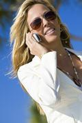 executive woman on cell phone in the sun - stock photo