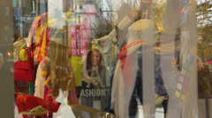 Consumer passing Shopping Window Zeil shopping street Frankfurt am Main Germany Stock Footage