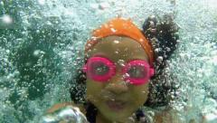 Slow motion of young girl diving into water Stock Footage