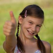 Young girl showing thumbs up Stock Photos