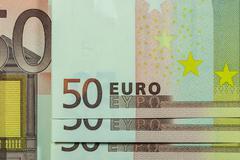 50 euro banknote, macro lens closeup, horizontal pattern - stock photo