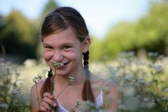 young girl holding a flower - stock photo
