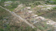 Stock Video Footage of Tornado Damage Destruction path through small residential community.