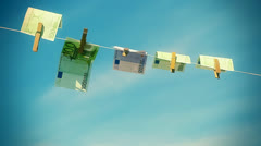 Euro banknotes  hanging on rope in wind on a blue sky background Stock Footage