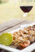 Grilled shrimp skewers with fresh lemon Stock Photos