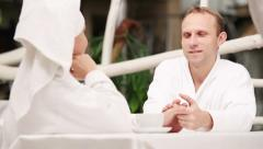Young Couple nicely talking after morning bath Stock Footage