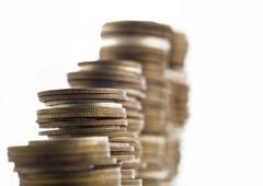 Growth - towers assembled of coins shallow dof Stock Photos